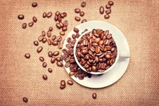 Free Cup With Coffee Beans On Fabric Texture Background Royalty Free Stock Image - 19756826