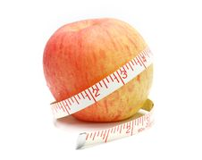 Apple And A Measure Tape, Diet Concept Royalty Free Stock Image