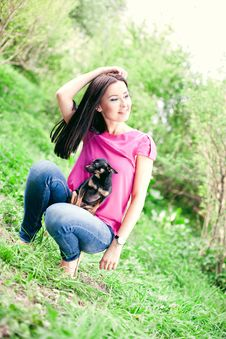 Beautiful Girl With A Puppy In The Garden Royalty Free Stock Photos