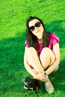 Free Girl With Glasses And A Puppy In The Garden Royalty Free Stock Photography - 19758647
