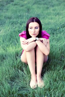 Pretty Young Woman Outdoor In The Grass Stock Image