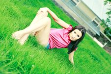 Free Girl Poses On The Green Grass Stock Photography - 19758872