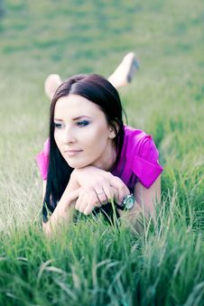 Free Pretty Young Girl Relaxing On The Lawn Stock Photography - 19758952