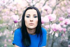 Girl And Magnolia Flowers Stock Images
