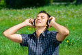Free Young Man Listening Music Outdoors Stock Photography - 19763912