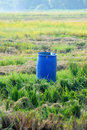 Free Blue Tank In The Middle Of Paddy Field Stock Images - 19764174