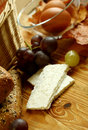 Free Goat Cheese And Grapes On Old Wooden Stock Images - 19768244