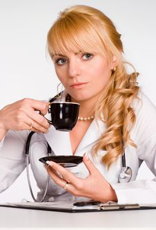 Free Young Doctor Drinks Tea Royalty Free Stock Photo - 19760875
