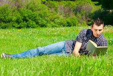 Free Young Man Reading Book Outdoors Stock Photo - 19763910