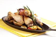 Roasted Chicken Drumsticks And Potatoes Royalty Free Stock Photos