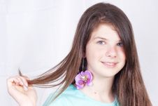 Free Young Girl Showing Her Earring Royalty Free Stock Images - 19768999