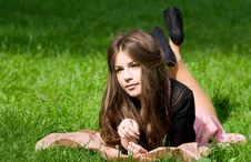 Girl Lying In Th Park Royalty Free Stock Photo