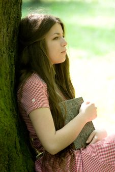 Girl With Book In The Park Stock Photo