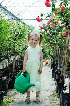 Free A Girl With A Watering Can Royalty Free Stock Photography - 19769607