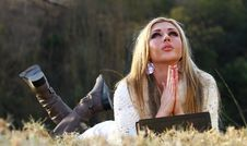 Free Blonde Lady Praying Lying On Her Stomach Royalty Free Stock Photography - 19773247