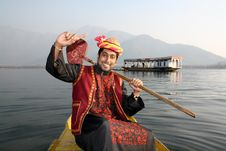 Rural Pathani Boy Singing On A Boat Hand Raised Stock Image