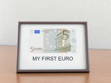Free Five Euro In The A Frame Royalty Free Stock Photography - 19777627