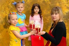 Free Young Woman Give Gifts To The Children Stock Photos - 19781543