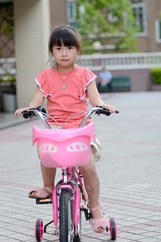 Asian Child Riding A Bicycle Stock Photography