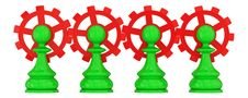Four Green Pawns Merged With Red Gears. Royalty Free Stock Image