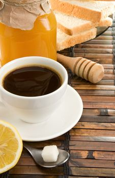 Coffee, Honey, Lemon And Bread On Table Royalty Free Stock Photos