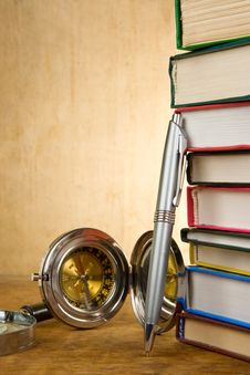 Free Pile Of Books And Pens On Wood Royalty Free Stock Photos - 19784438
