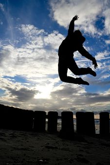 Free Silhouette Of Girl Jumps In Sky Royalty Free Stock Image - 19785486