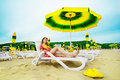 Free Beautiful Woman Laying On The Beach Under Umbrella Royalty Free Stock Images - 19793749