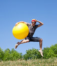 Free Young Man Jump With Yellow Ball Stock Photos - 19795813