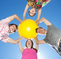 Free People Hold Yellow Ball Across Sky Stock Images - 19795824