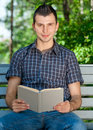 Free Young Man Reading Book Outdoors Royalty Free Stock Photos - 19795908