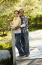 Free Caucasian Couple On Outdoor Wooden Bridge Royalty Free Stock Image - 19799696