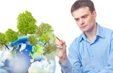 Free Caucasian Businessman Drawing Tree On The Earth Stock Images - 19790044