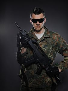Free Young Soldier In Camouflage With A Gun. Stock Image - 19790731