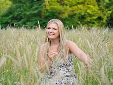 Pretty Summer Woman On Yellow Wheat Field Stock Photography