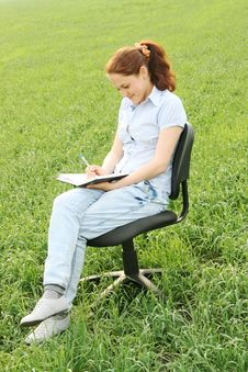 The Girl Sitting In The Field Royalty Free Stock Photography