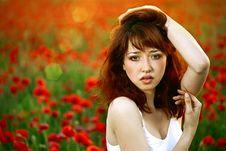 Woman Closeup Portrait In Poppy Field Stock Image