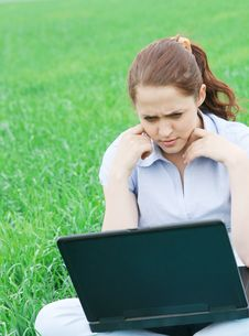 Girl Sitting In The Field Stock Photos