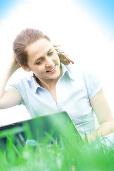 Girl Sitting In The Grass Stock Photography