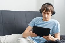 Free Young Man Using A Laptop And Listening Music Stock Image - 19794501