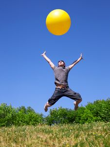 Free Young Man Jump With Yellow Ball Stock Images - 19795804