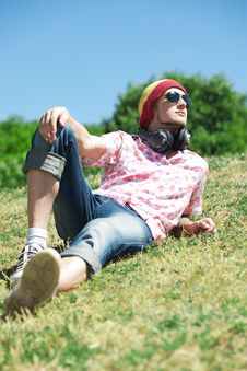 Free Young Man  Laying On Grass Royalty Free Stock Photos - 19795898