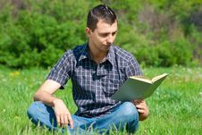 Free Young Man Reading Book Outdoors Stock Photo - 19795910