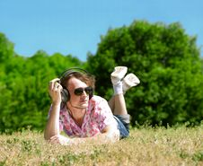 Free Young Man  Laying On Grass Royalty Free Stock Images - 19795939