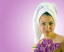 Free Young Girl With Towel And Lilac Stock Images - 19797384