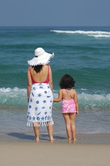 Free Mother And Her Baby On The Beach Stock Photo - 19799650