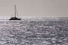 Catamaran On A Silver Sea Royalty Free Stock Photo