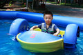Free Asian Boy Is Driving Boat Royalty Free Stock Image - 19800296