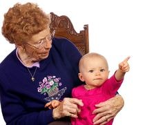 Great Grandma With Grand Baby Enjoying Each Other Stock Photos