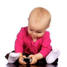 Free Infant Baby Girl Playing With T.v. Remote Stock Photo - 19800150